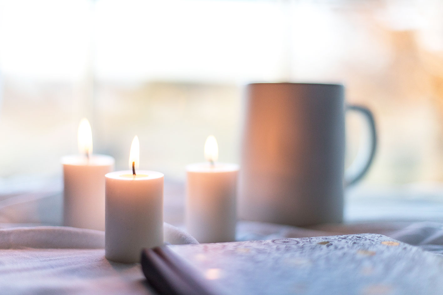 candles , coffee and your notebook, branding goals and intentions for the new year